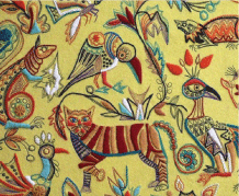 textile with yellow background with colourful wildlife stitched into it.